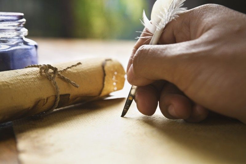 Writing hand with feather